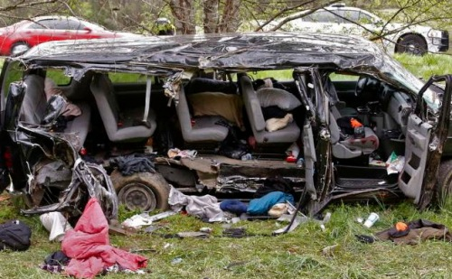 Investigators work at the scene where three people died early Monday, April 6, 2015, when a van carrying members of two heavy metal bands crashed near the town of Commerce, Ga., about 65 miles northeast of Atlanta, according to authorities. Members of the Atlanta-based band,